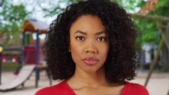 Thumbnail for African-American woman with serious look on face at playground in public park