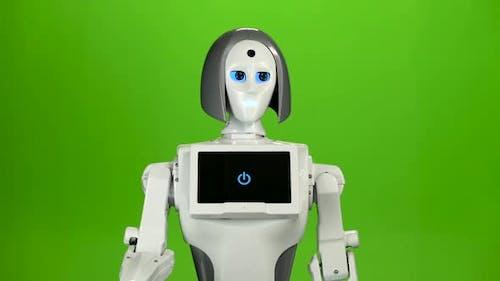 Robot sagt Hallo und auf Wiedersehen. Grüner Bildschirm
