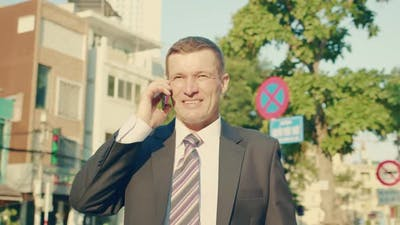 A Man Talking on a Cell Phone in the Street