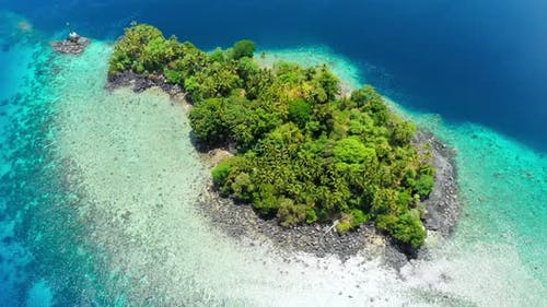 Aerial: flying over tropical island Banda Islands Maluku Indonesia