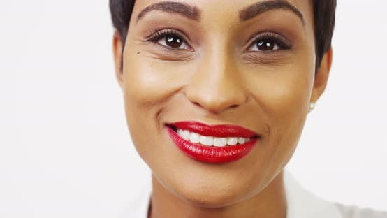 Thumbnail for Close up front view of pretty black woman with red lipstick smiling and laughing