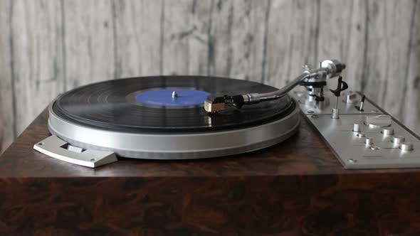 Record Player Playing a Vinyl Record