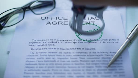 Thumbnail for Office Rental Agreement Approved, Hand Stamping Seal on Business Document, Close
