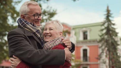 Senior Boyfriend and Girlfriend Hugging
