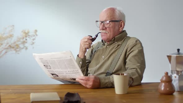 Cover Image for Elderly Man Smoking Pipe and Reading Newspaper
