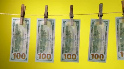 Dollars Dry on a Clothespin Rope
