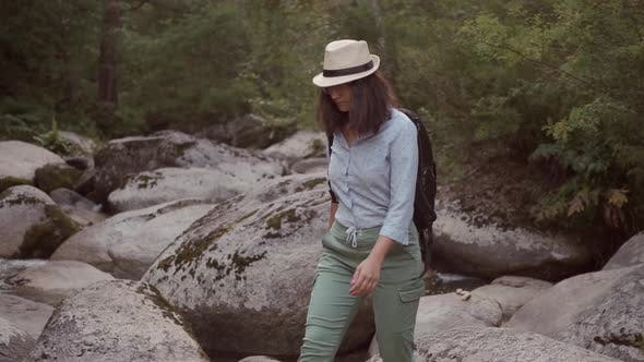 Thumbnail for Woman Traveler Walks on Huge Stones in Nature
