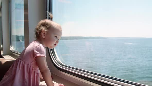 Thumbnail for Cute Baby Girl Looking Out Ferry Window