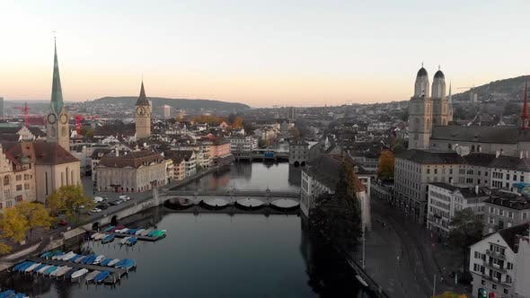 Thumbnail for Zurich aerial cityscape crane up shot at sunrise, Switzerland