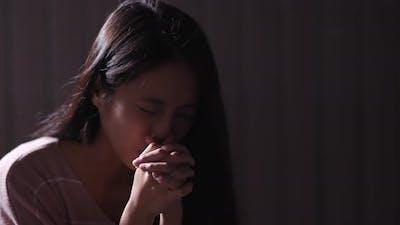 Woman Pray in The Dark