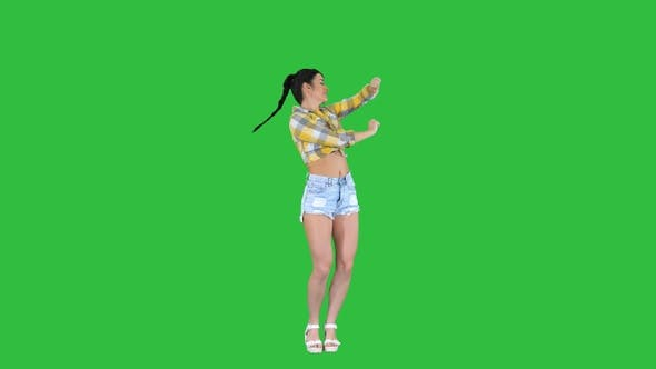 Thumbnail for Girl in square shirt and jeans shorts sneakers, dancing