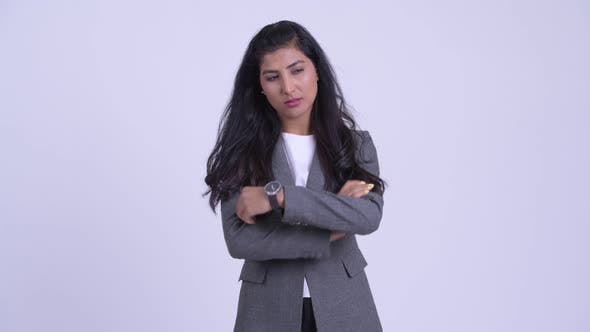 Thumbnail for Young Serious Persian Businesswoman Thinking and Looking Down