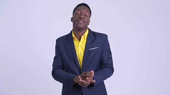Young Happy African Businessman Looking Excited While Talking