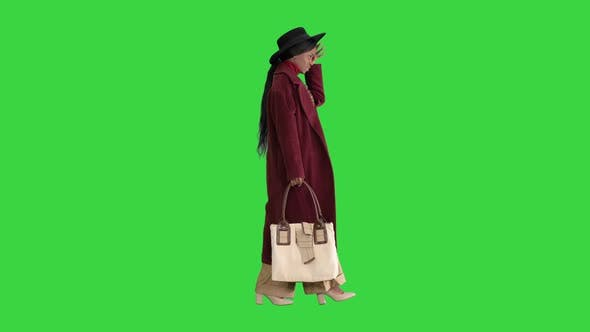 Thumbnail for Pretty American Woman in a Hat Walking on a Green Screen, Chroma Key.