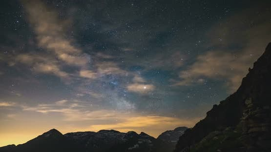 Time Lapse of the Milky way and the stars in summer night sky rotating over the Alps
