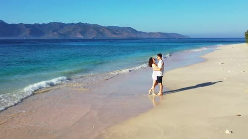 Fun People in Love Dating on Vacation Enjoy Luxury on Beach on Paradise White Sand