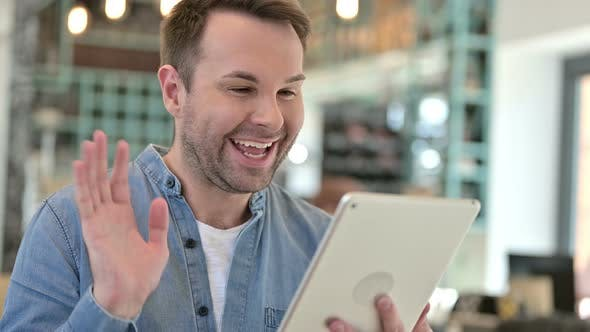 Thumbnail for Portrait of Video Chat on Tablet By Casual Man
