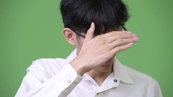 Thumbnail for Young Asian Businessman Covering Eyes Not Wanting To Look