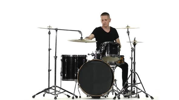 Thumbnail for Energetic Professional Musician Plays Good Music on Drums, White Background, Slow Motion