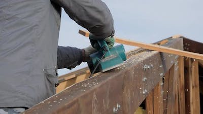 Planing a Tree with an Electric Planer.