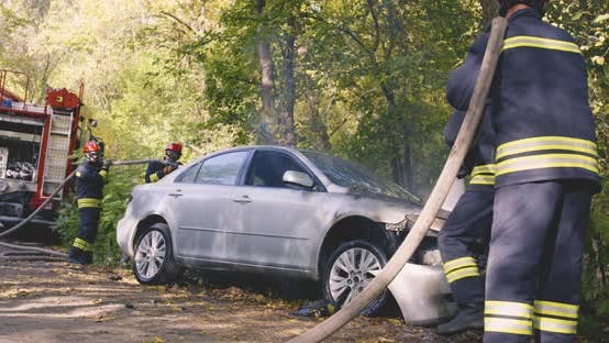 Thumbnail for Firefighters Extinguishing Fire on Broken Car