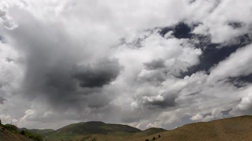 A Little Rain Pass Over Arid Hills