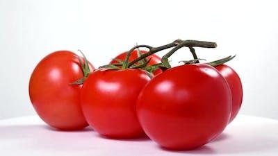 Tomatoes rotating on white background