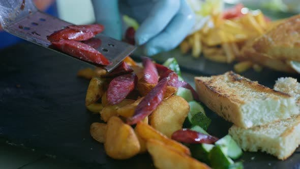 Thumbnail for Delicious Food, Fragrant Fried Potatoes with Hunting Sausages and Slices of Toast on Black Plate in