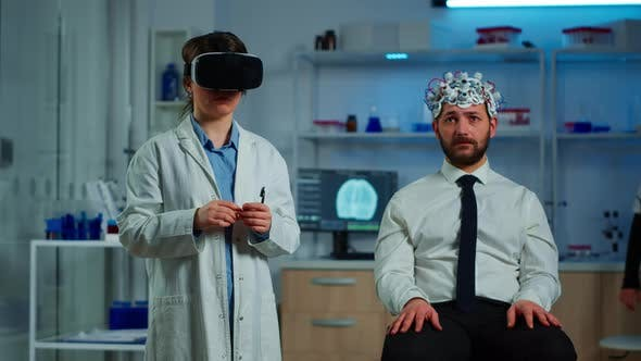 Neurological Scientist Using Medical Inovation in Lab Wearing VR Glasses