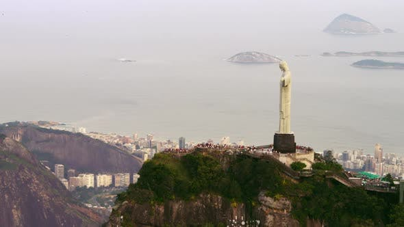 High-definition aerial shot of Christ the Redeemer and tourists.