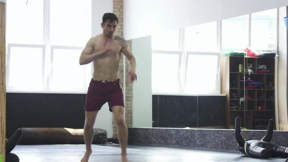 Thumbnail for Full Length Shot of a Ripped Mma Fighter Practicing Hich Kicks at the Gym