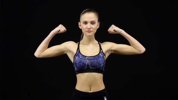 Thumbnail for Woman Showing Off Muscles