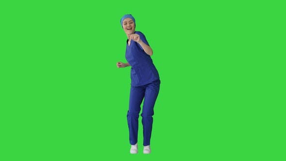 Thumbnail for Smiling Female Medical Doctor in Blue Uniform Dancing and Cheering on a Green Screen, Chroma Key.