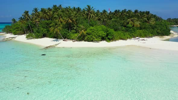 Thumbnail for Natural overhead abstract shot of a white sandy paradise beach and blue ocean background in hi res 4