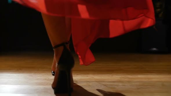 Thumbnail for Female Model In Heels Walking On Hardwood Floor In Red Dress