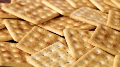 Background of Stacked Salty Cracker Cookies Close Up