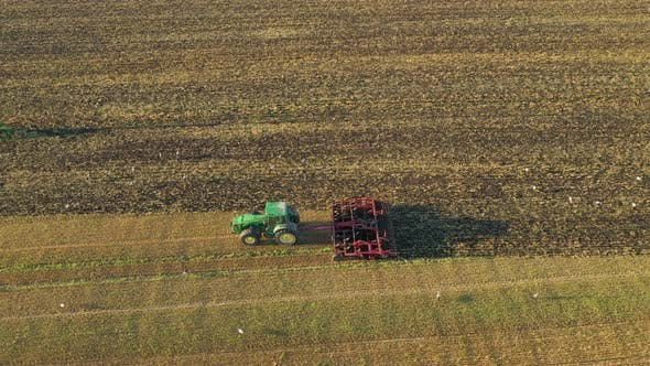 Tractor Cultivating Earth After Harvesting