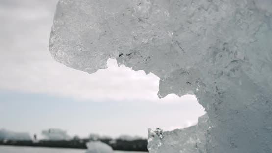 Crystal Ice Melting on Volcanic Beach in Diamond Beach on Iceland or Jokulsarlon. Drop Water. Close