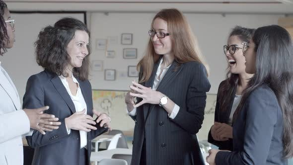 Thumbnail for Cheerful Businesswomen Talking in Office