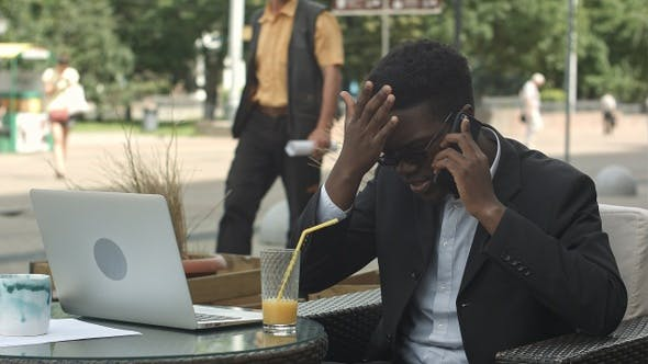 Thumbnail for Afro-American Businessman Negotiating by Phone Defending