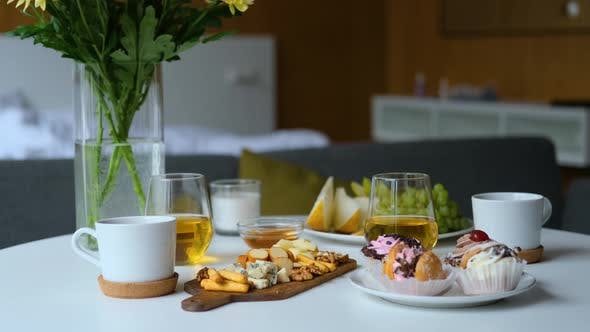 breakfast with flowers on the table in the bedroom