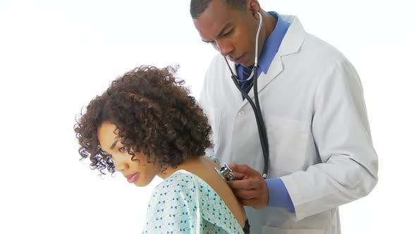 Thumbnail for African-American doctor examining patient with stethoscope