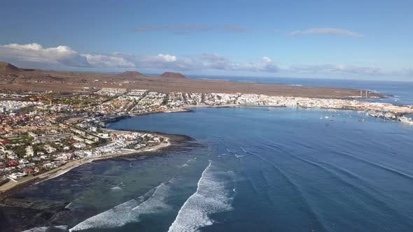 Thumbnail for Aerial View of Waves Crashing on the Bay of Corralejo, Fuerteventura