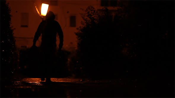 Thumbnail for Man Carrying Bag in the Dark
