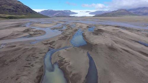 Flying Above a Glacial River Transporting Deposits from Vatnajokull Glacier in Iceland