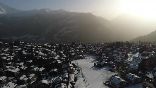 Aerial Shot of a Village in Switzerland That Was Covered in Snow at a Popular Destination for Skiers