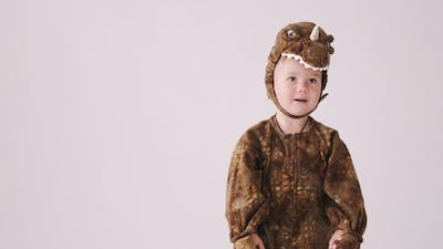 Little Boy in Dragon Costume on Halloween Party