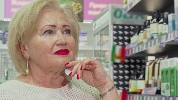 Thumbnail for Cropped Shot of Elegant Elderly Woman Shopping at Drugstore