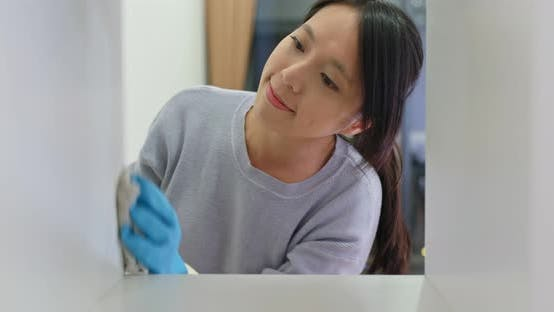 Thumbnail for Woman Clean the Cabinet at Home