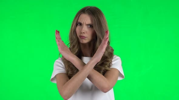 Thumbnail for Lovable Girl Strictly Gesturing with Hands Crossed Making X Shape Meaning Denial Saying NO. Green
